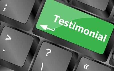 Testimonials key on a computer keyboard