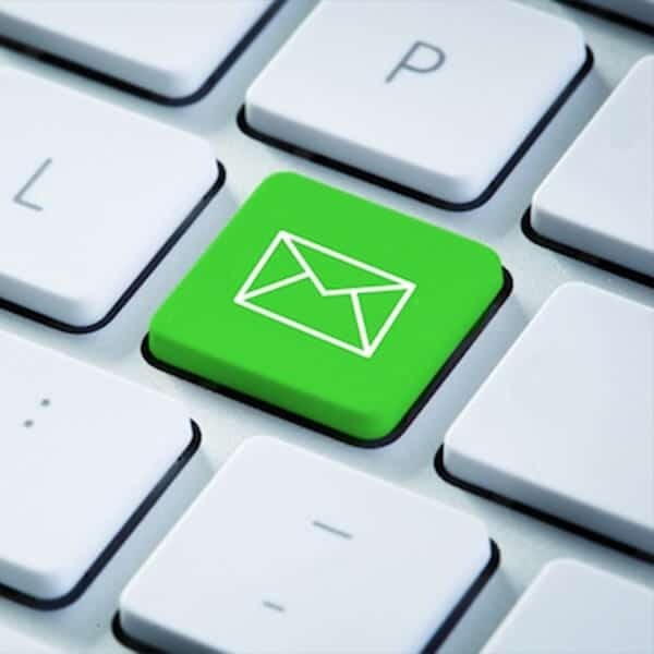 Green email button on a computer keyboard